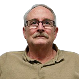 Image of Dave Martin, a pale-skinned male with short gray hair, mustache, and glasses.